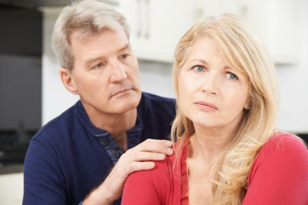 Mature Man Comforting Woman With Depression