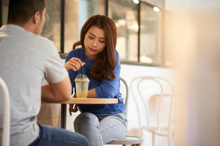 Woman on date with man having drink